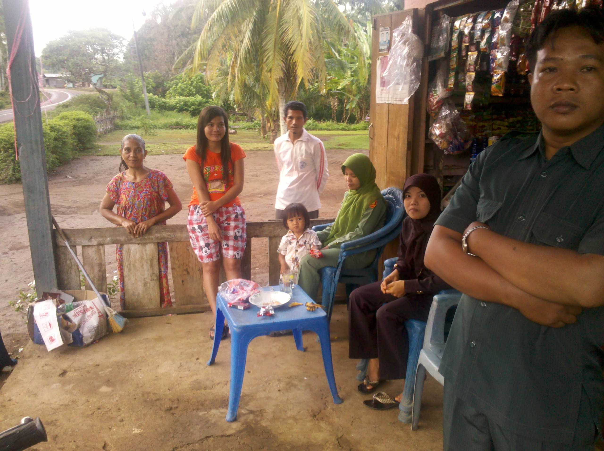 Family outside their shop