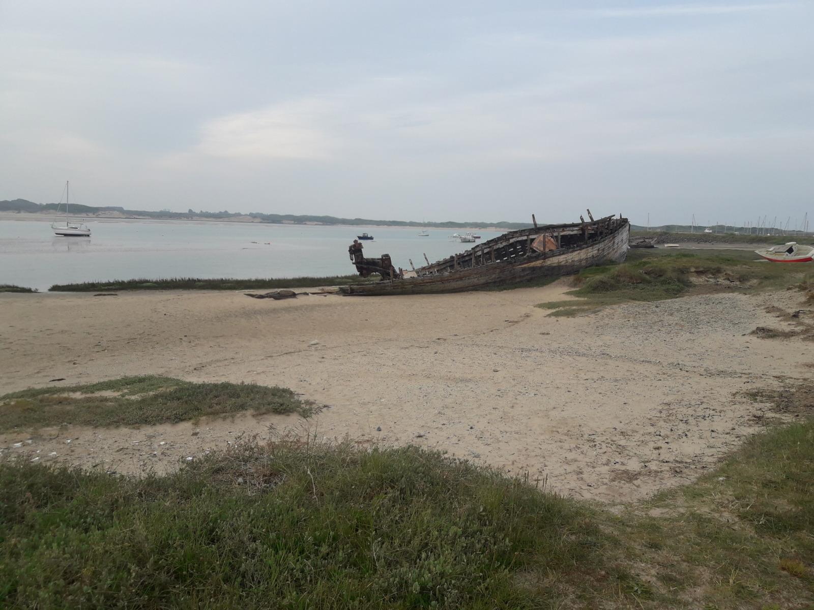 Beach, rotting boat