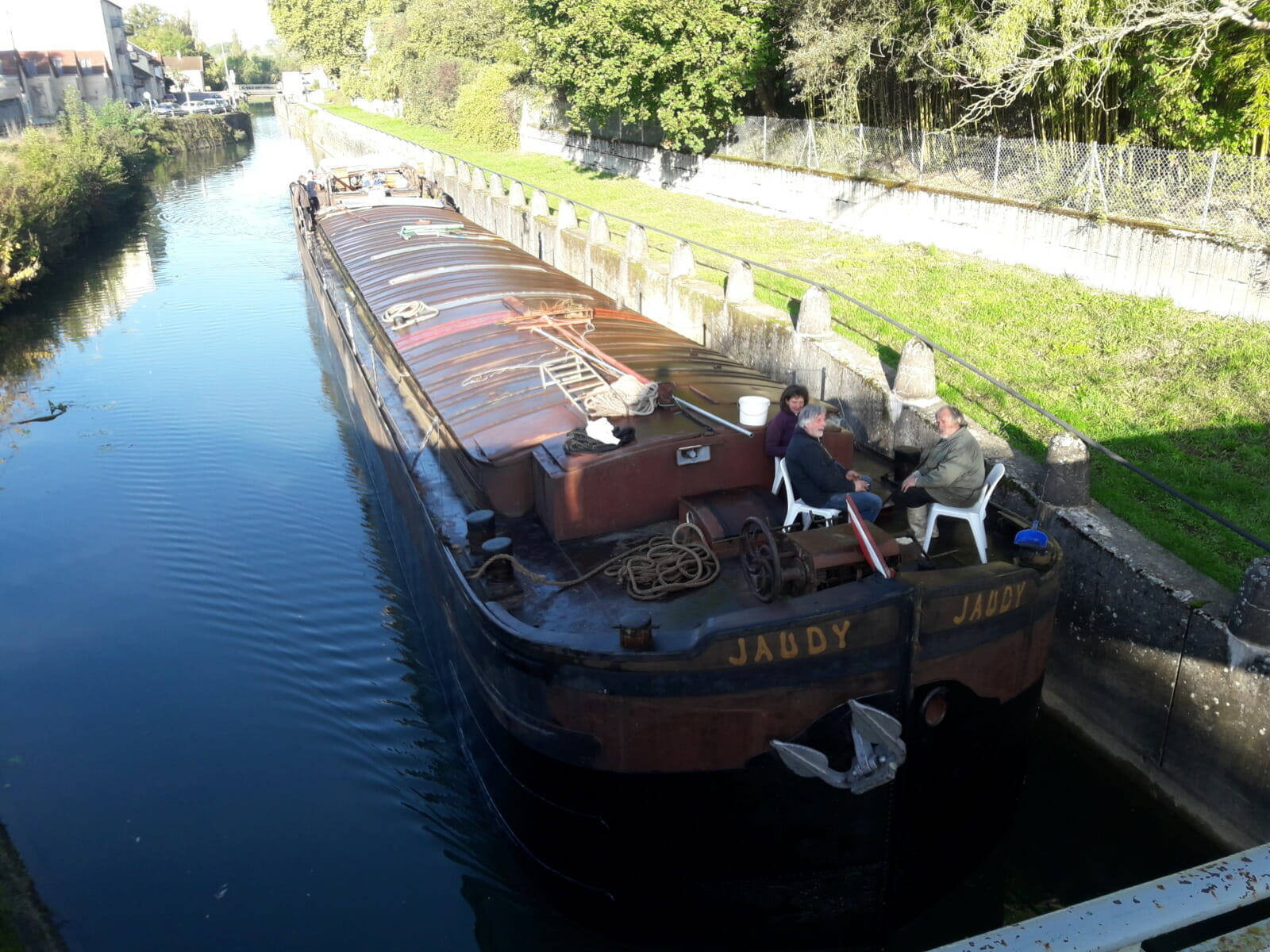 Barge with people on