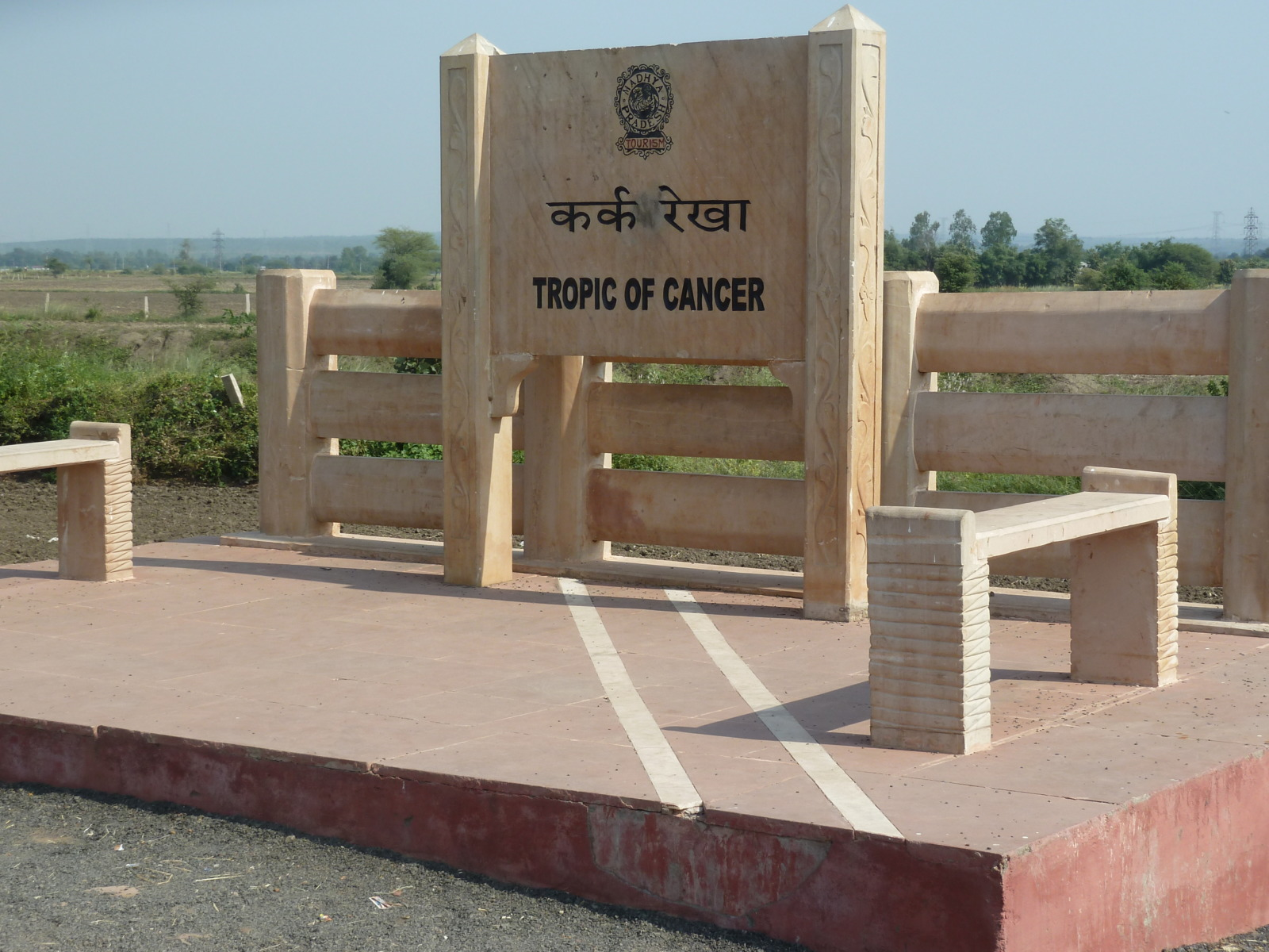 The Tropic of Cancer line in the road