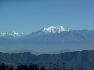 Finally at the top of the Tribhuvan Highway at the Simbhanjyang Pass looking at the snow covered mountains in the distance