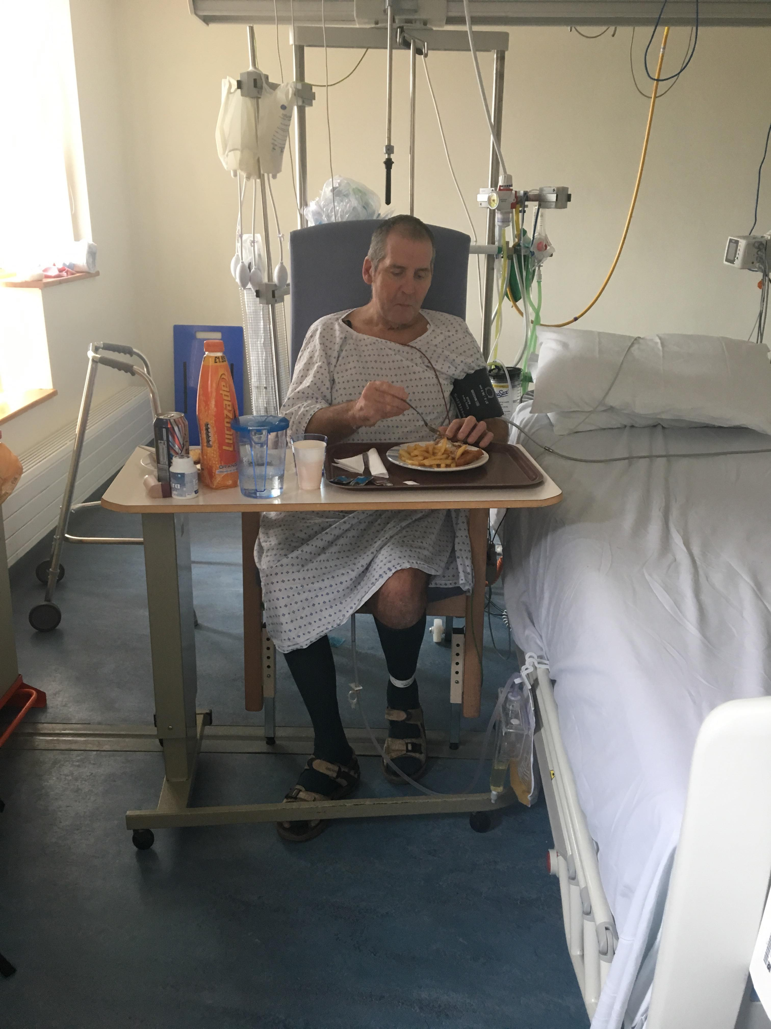 Man in hospital eating